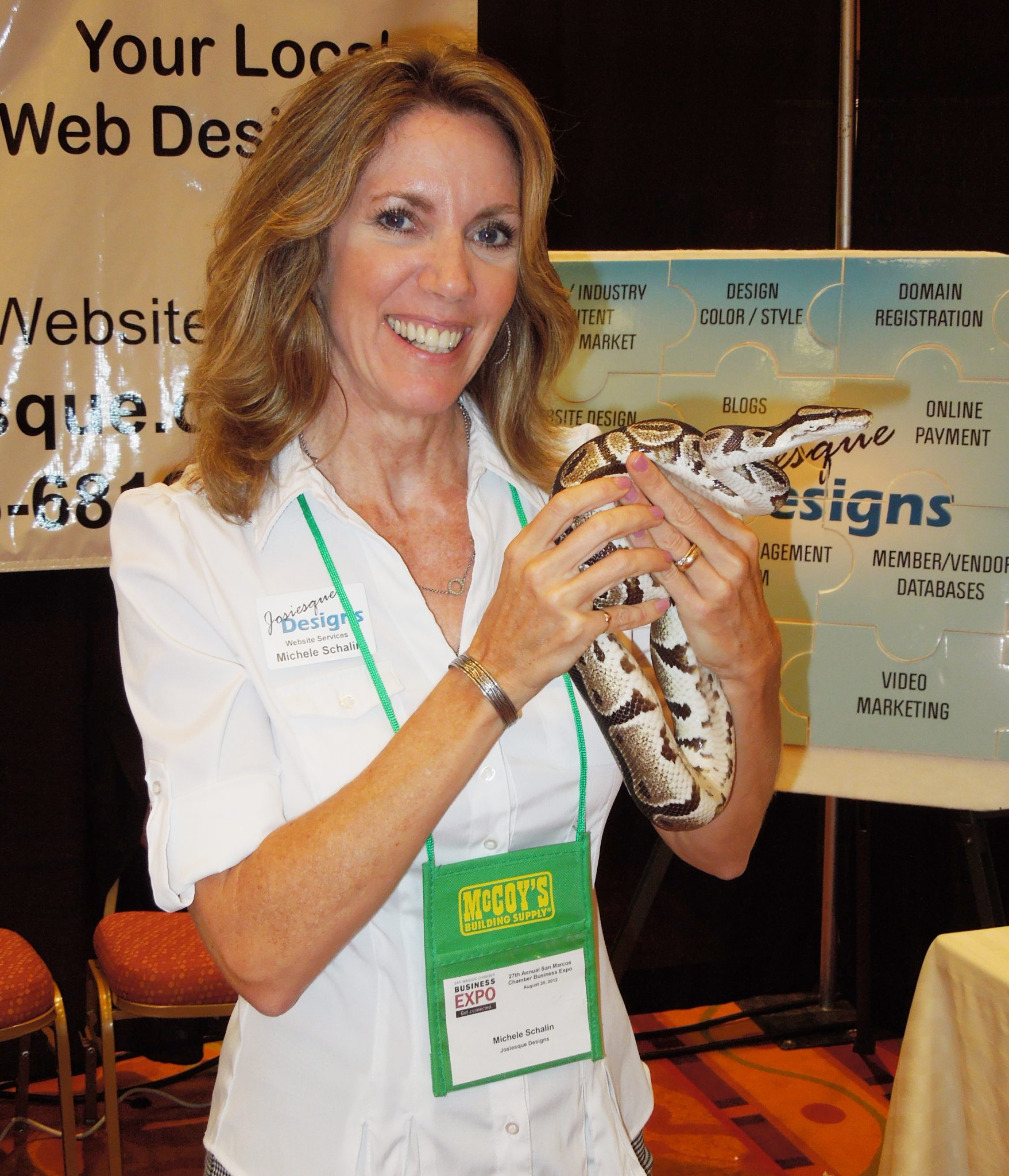 Michele Schalin with Josiesque Designs with a snake from the San Marcos Nature Center